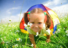 Girl is playing outdoors under tent Stock Image