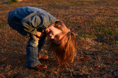 Girl playing outside. At sunset Royalty Free Stock Image