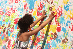 Girl playing with paint Royalty Free Stock Images