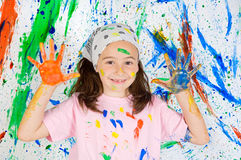 Girl playing with painting Royalty Free Stock Photos