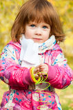 Girl playing in the park. With a Rainbow spiral spring Royalty Free Stock Images