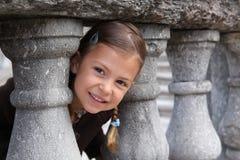 Girl playing peek a boo Stock Photos