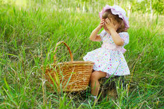 Girl playing peekaboo stock images