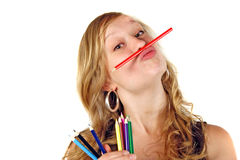 Girl playing with pencils Royalty Free Stock Image