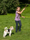 Girl playing with pet dog Royalty Free Stock Image