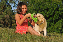 Girl playing with pet dog Stock Photography