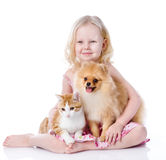 Girl playing with pets - dog and cat. Looking away. isolated on royalty free stock photography