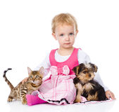 Girl playing with pets - dog and cat. looking at camera. isolate. D Royalty Free Stock Images
