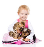 Girl playing with pets - dog and cat. looking at camera. On white royalty free stock photo