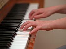 Girl playing piano. At home Stock Photos