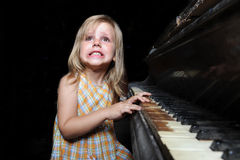 Girl playing on an  piano. Stock Photo