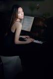 Girl playing piano Stock Photo