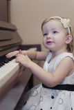 GIRL PLAYING PIANO Royalty Free Stock Image