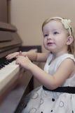 GIRL PLAYING PIANO royalty free stock image