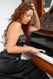 Girl playing a piano Royalty Free Stock Photo