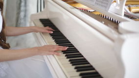 Girl playing the piano stock video footage