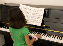 Girl Playing Piano Royalty Free Stock Photo