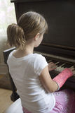 Girl playing piano in cast Royalty Free Stock Photos