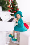 Girl playing the piano. Girl in costume leprechaun playing the piano Stock Photos