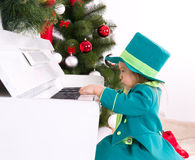 Girl playing the piano. Girl in costume leprechaun playing the piano Stock Images