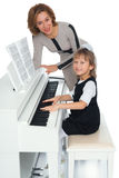 Girl playing the piano Royalty Free Stock Image