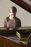 Girl Playing Piano Royalty Free Stock Images