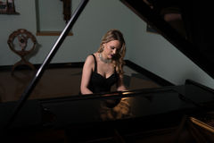 Girl Playing the Piano Royalty Free Stock Photography