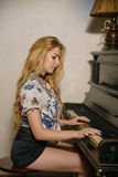The girl playing the piano Royalty Free Stock Images