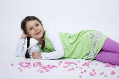 Girl playing with pink grit. On white background Stock Photos