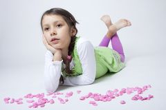 Girl playing with pink grit. On white background Royalty Free Stock Photo