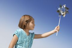 Girl Playing With Pinwheel Toy Royalty Free Stock Images