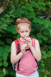 Girl playing a pipe Stock Photography