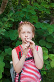 Girl playing a pipe Royalty Free Stock Image