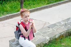 Girl playing a pipe Royalty Free Stock Photos