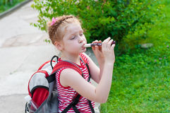 Girl playing a pipe Royalty Free Stock Photo