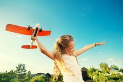 Girl playing with plane. Child playing with plane. Happy girl play outdoors royalty free stock image