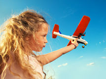 Girl playing with plane Royalty Free Stock Photo