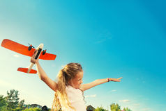 Girl playing with plane Stock Photography