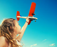 Girl playing with plane. Child playing with plane. Happy girl play outdoors royalty free stock photography