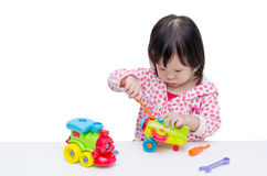 Girl playing with plane and train toy Royalty Free Stock Photo