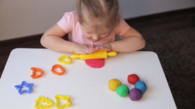 Girl playing with plasticine stock video footage