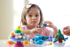 Girl playing with play dough Stock Photos