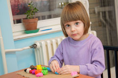 Girl playing with play dough - plasticine Royalty Free Stock Photography