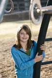Girl playing at a playground Stock Photos