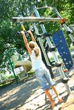 Girl playing at playground Royalty Free Stock Images