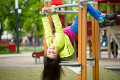 Girl is playing on playground royalty free stock photography