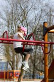 Girl. Playing on the playground Stock Photography