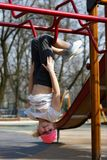 Girl. Playing on the playground Stock Image