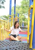 Girl playing at playground. In the park Stock Images