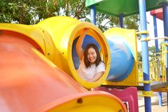 Girl playing at playground. In the park Stock Photography